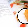 Catálogo abierto con corte ampliado: ligera visibilidad del hilo (puntada)