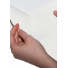 hendidura en el reverso del papel autoadhesivo blanco
